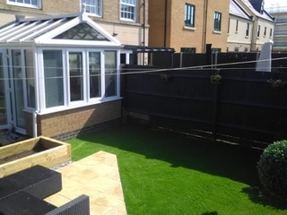after landscape and artificial grass